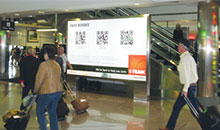 A QR Code program shown in an airport advertisement.