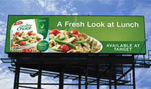 A digital billboard showcasing an easy to cook meal that you can buy at Target