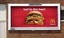 A bright and bold 'Big Mac' is showcased on a Jr. poster billboard.