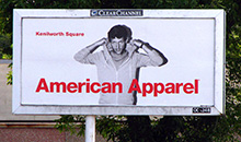 An American Apparel advertisement shown on a junior poster billboard.