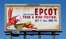 A colorful Epcot Food and Wine festival advertisement on a poster billboard.