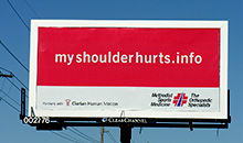 A poster billboard with a simple message to help drive traffic to a sports medicine website.