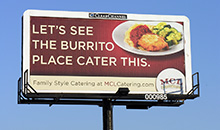 A poster billboard campaign that compares family style catering to a burrito place.