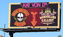 A creative design is used to promote Kat Von D's Tattoo on a premiere panel billboard.