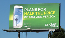 A 'Cricket' advertisement on a premiere panel billboard.