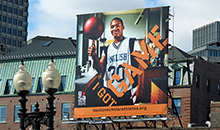 A Premiere Square billboard promoting Boston Scholar Athletes with 'I got game'.
