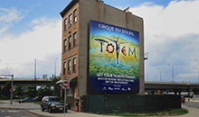 Cirque Du Soleil Totem is promoted on a premiere square billboard in Boston.