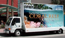 A mobile billboard promotes an IMAX feature film.